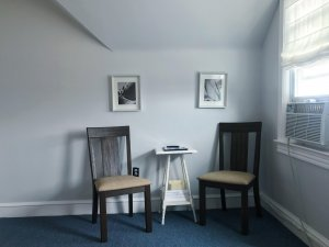 Two chairs at a small table