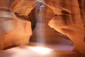 A shaft of light in a narrow slot canyon