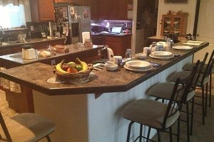 A kitchen island set for breakfast