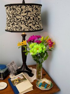 A lamp and bouquet of flowers