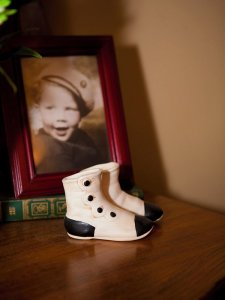 Small boots and a picture of a child