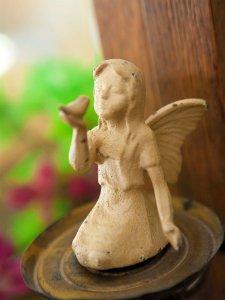 Sculpture of an angel child holding a bird