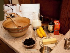 A counter with breakfast ingredients and a mixing bowl laid out