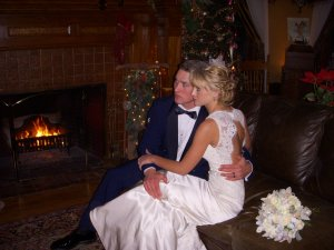 Bride and groom near a fireplace
