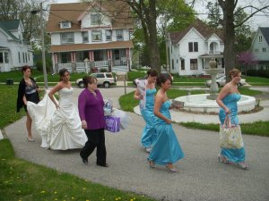 A group accompanying a bride on the grounds