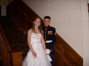 Groom in military uniform with bride