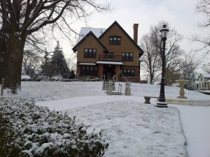 The inn exterior with snow on the ground