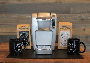 Coffee mugs and a coffee machine