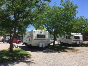 Moab Rim Campark RV Sites camper trailers trees