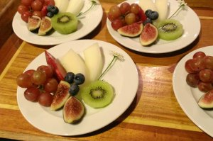 Grapes, kiwifruit, figs, and blueberries on plates
