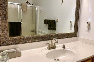 bathroom sink mirror and shower