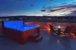rooftop jacuzzi tub at night
