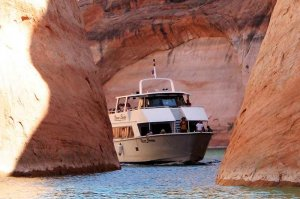 boat coming through canyon on Lake Powell
