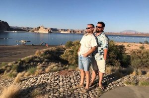 Bed & Breakfast hosts Eric and Jarod posing for photo with Lake Powell in the background