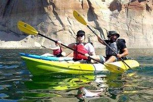 tourists floating on kayak