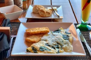 tasty turkey, spinach, havarti omelette with hollandaise
