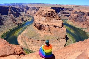 Guy wrapped in Pride Flag at Horseshoe Bend