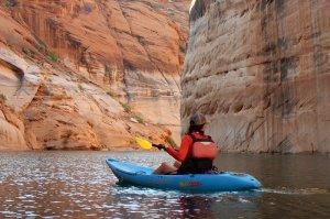 tourists kayaking in canyon