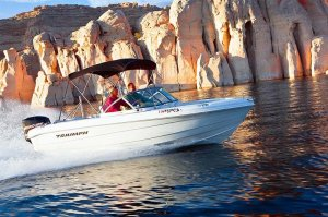 19' Open-bow Ski Boat pulling a skier on Lake Powell