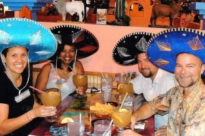 Gay nightlife with friends drinking margaritas at a local restaurant