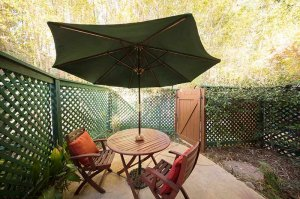 Outdoor table and chairs with shade umbrella