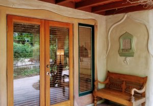 Glass doors to a patio and yard