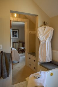 robes and view from tub into sitting area
