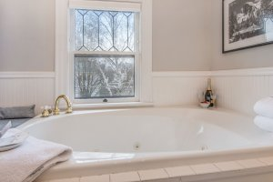 large jetted tub for two with view of garden