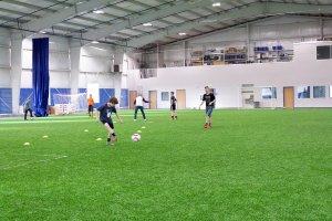 Shooters Soccer Club Facility interior team running drills