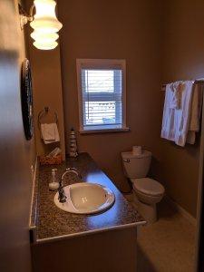 Washroom showing sink, vanity and toilet