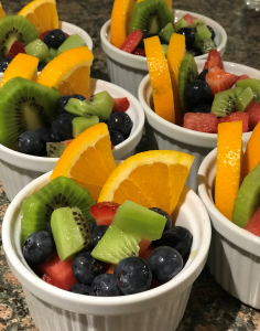 fresh fruit breakfast cups with blueberries, kiwis, oranges, and strawberries