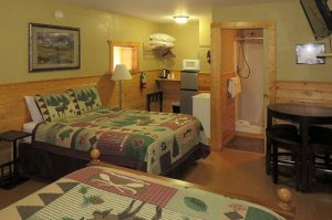 Two queen beds and kitchen