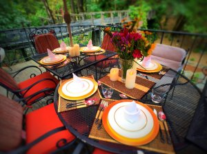 Gold Creek Inn deck with tables and chairs
