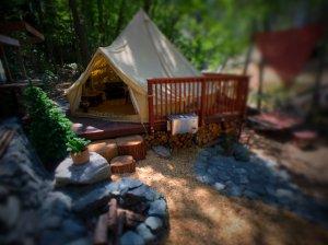 Wood railing next to tent