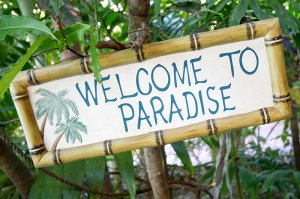 sign reading welcome to paradise