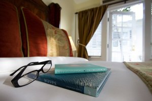 books and glasses on a bed