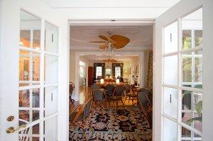 room with chairs seen through open doorway