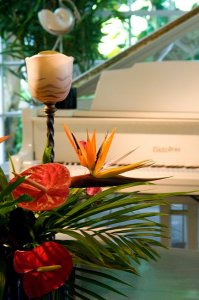 a floral arrangement and a piano