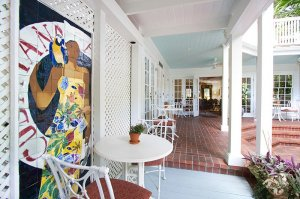 porch featuring mural of woman with parrot