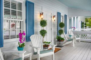 porch chairs on either side of a door