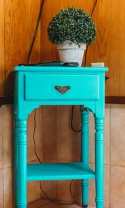 a flowerpot on a nightstand
