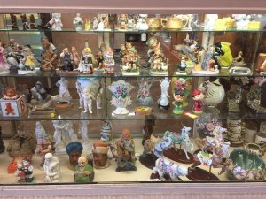 antque figurines on shelves