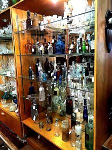 shelves with antique glass bottles