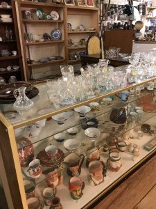 glass bowls and blue dishes in display case