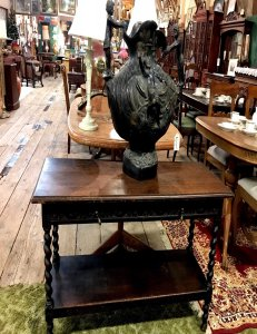 large ornate vase on small wooden side table