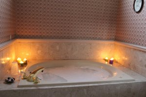 bathtub with lit candles