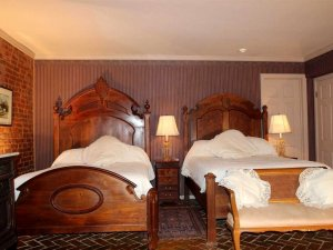 two beds with large headboards