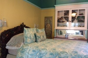 bed with blue paisley spread