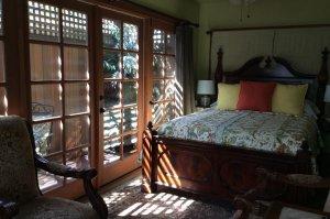 Bed beside glass doors