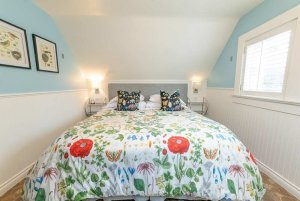 floral bed with throw pillows